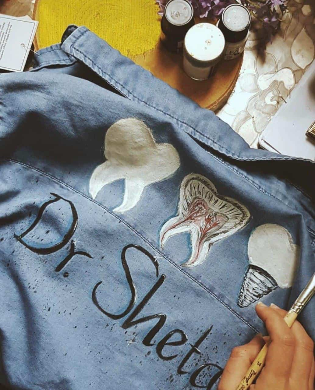 Art on Clothes businesses in Karbala jacket with painting of teeth in a dentist theme 1
